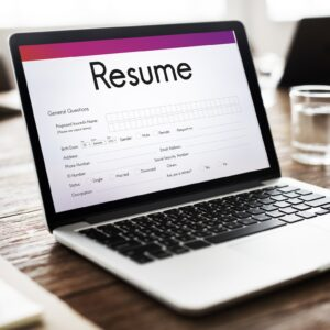 Laptop displaying a resume template.