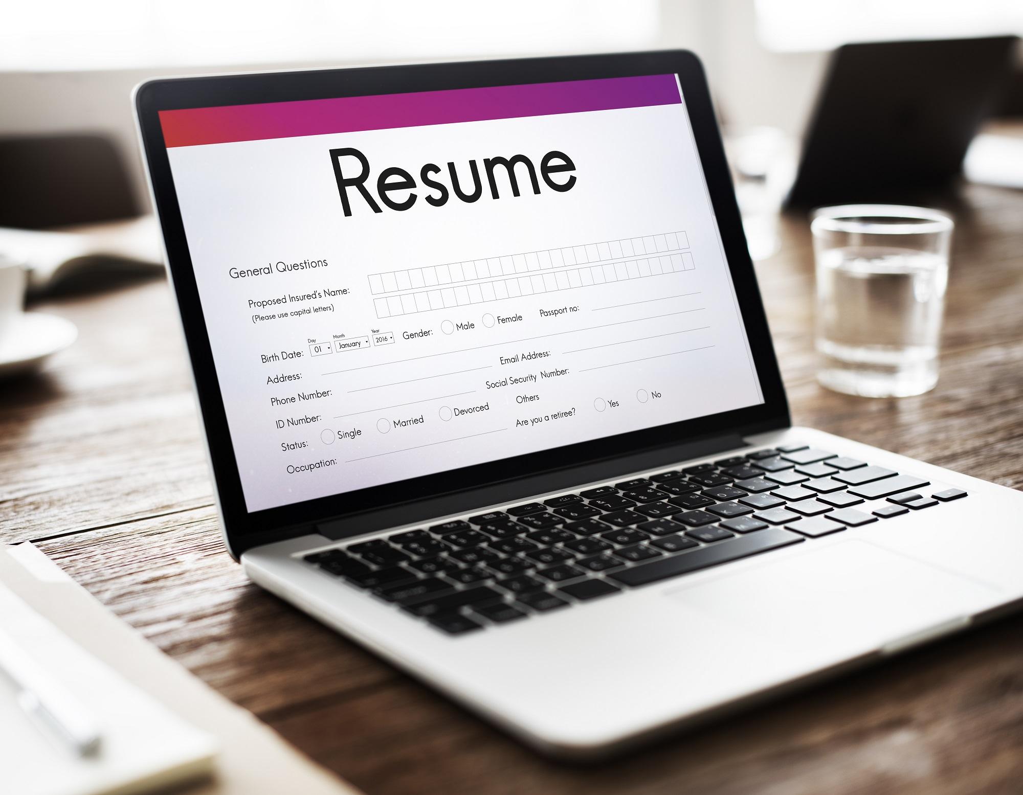 Laptop displaying a resume template.